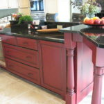 Red island in two tone kitchen