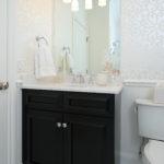 Elegant guest bath with dark Grabill vanity