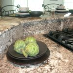Large granite island with 42″ bar top and backsplash