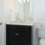 Elegant guest bath with dark Grabill vanity